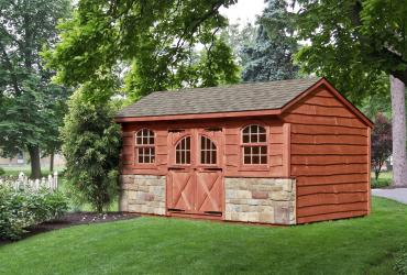 Quaker Shed with Stone and Heritage Siding